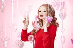 Jeune femme de luxe en rouge Photo libre de droits