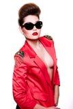 Jeune femme de mode avec le renivellement lumineux Photographie stock libre de droits