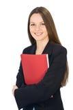 Jeune femme de sourire avec un dépliant dans des mains image stock