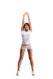 Jeune femme de sport faisant des exercices d'isolement sur le blanc Photo libre de droits
