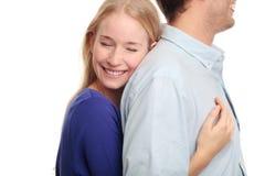 Jeune femme embrassant son ami Photographie stock libre de droits