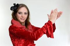 Jeune femme en rouge Photographie stock