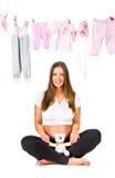 Jeune femme enceinte, d'isolement sur le blanc photos stock
