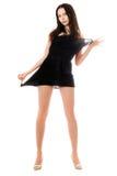 Jeune femme espiègle dans la robe noire image libre de droits