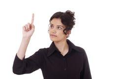 Jeune femme esquissant quelque chose avec son doigt photographie stock libre de droits