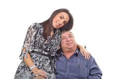 Jeune femme et vieux hommes Image stock