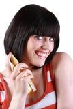 Jeune femme favorisant le produit de beauté Photographie stock libre de droits
