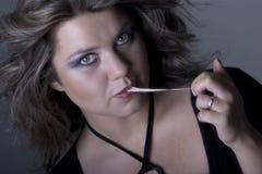 Jeune femme flirtant Images stock