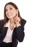 Jeune femme fouineuse écoutant sur la porte Concept pour des actualités Photos stock
