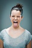 Jeune femme heureuse collant sa langue Photo libre de droits