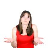 Jeune femme hors des idées d'isolement sur le fond blanc Photographie stock libre de droits