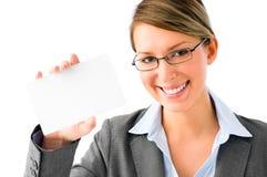 Jeune femme impertinente d'affaires avec la plaquette photo libre de droits