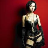 Jeune femme magnifique dans le corset Photo stock