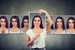 Jeune femme masquée exprimant différentes émotions photographie stock libre de droits