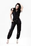 Jeune femme mince rectifiée dans des pantalons noirs Images stock