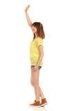 Jeune femme ondulant la vue de côté Image stock