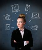 Jeune femme pensant avec les instruments tirés autour de sa tête Image stock