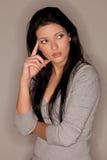 Jeune femme pensive photo stock