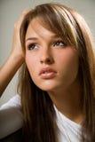 Jeune femme pensive Photographie stock