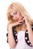 Jeune femme pensive dans la couche de point de polka Images libres de droits