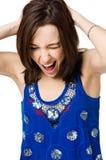 Jeune femme pleurante d'isolement sur le fond blanc Photographie stock libre de droits