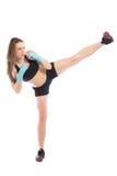 Jeune femme posant dans un support de boxe Photographie stock