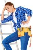 Jeune femme pratique de DIY avec un problème Images stock