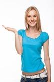 Jeune femme retardant sa main Photographie stock
