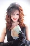 Jeune femme retenant l'euro argent Photographie stock