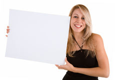 Jeune femme retenant un signe blanc blanc Image stock