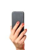 Jeune femme retenant un téléphone portable Image stock