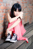 Jeune femme semblant triste Photos stock