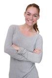 Jeune femme souriant avec des bras croisés Photo libre de droits