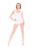 Jeune femme souriant dans les sous-vêtements blancs Photographie stock
