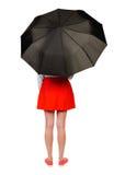 Jeune femme sous un parapluie Images stock