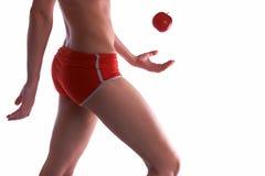 Jeune femme sportif avec la pomme image libre de droits