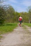 Jeune femme sportive courante Image libre de droits
