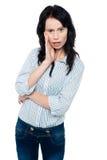 Jeune femme stupéfaite Photographie stock libre de droits