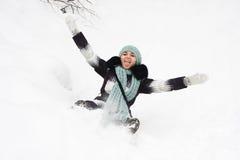 Jeune femme sur la neige Photographie stock libre de droits