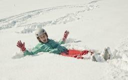 Jeune femme sur la neige Photos stock