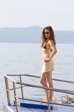 Jeune femme sur le bateau Photographie stock libre de droits