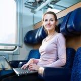 Jeune femme sur le train Photos libres de droits