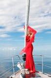 Jeune femme sur le yacht Photos stock