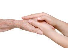 Jeune femme tenant sa main de grand-mère Images stock