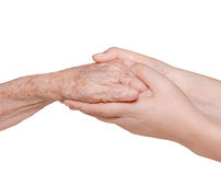 Jeune femme tenant sa main de grand-mère Photographie stock