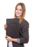 Jeune femme tenant son dossier d'application image stock