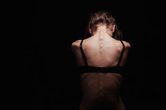 Jeune femme triste avec le dos nu Fille sexy de corps Image stock
