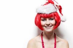 Jeune femme utilisant le chapeau de Santa. Photos stock