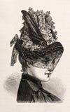 Jeune femme utilisant un chapeau élégant Image libre de droits
