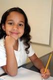 Jeune fille à l'école image stock
